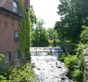 A brook flows from Railroad Pond, just outside the Milford Oval, and under the bridge leading to Elm Street.