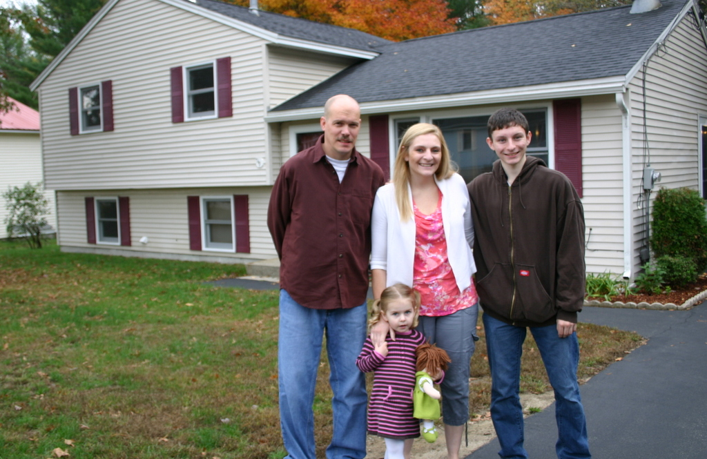 Happy new owners: The Cook-Coulon family were excited to settle into their new home in Milford, with the help of Liz Bruce, of Apple Orchard Realty.